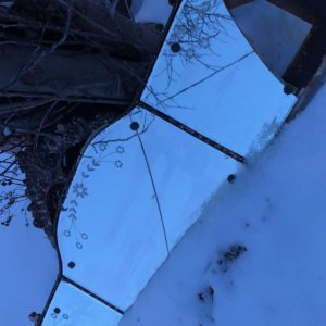 Cracked Vintage Mirror in the Snow